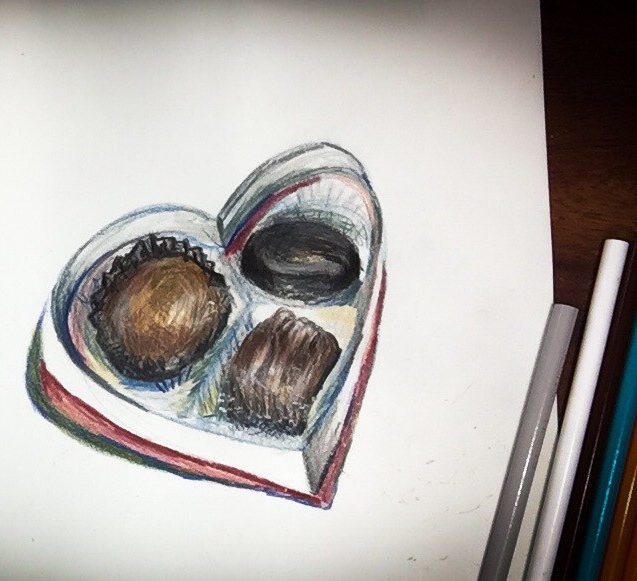 Time lapse colored pencil drawing of a box of chocolates.