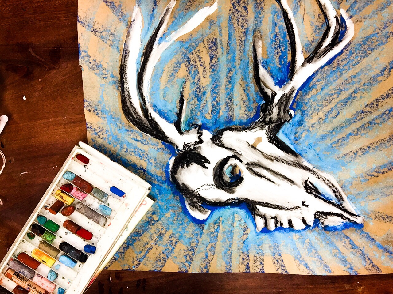 Learn how to paint a deer skull with acrylic (or liquid tempera!) paint, oil pastels and baby oil. This is one of my favorite art techniques to teach from 5th-12th grade! It's easy, approachable and has vibrant results. This is perfect or the classroom or the home studio.